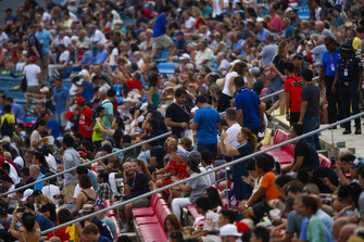 Fans ina grandstand watch FP3