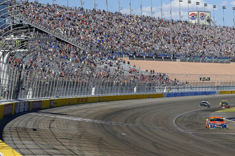Brad Keselowski, Team Penske, Ford Fusion Autotrader drives under the checkered flag to win