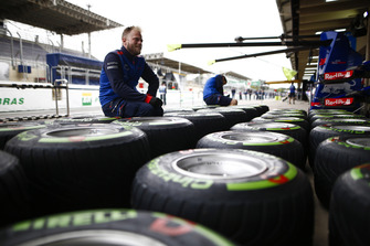 A Toro Rosso mechanic works on Pirelli tyres