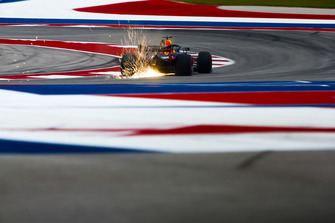 Sparks fly from the rear of Daniel Ricciardo, Red Bull Racing RB14