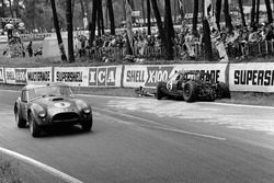 Peter Bolton, Ninian Sanderson, AC Cobra 289 Ford Coupe, passes the wreckage of Richard Attwood, David Hobbs, Lola GT Mk 6 Ford