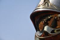Romain Grosjean, Haas F1 Team VF-18 reflected in a fireman helmet