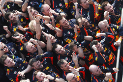 The Red Bull team celebrate victory at the podium