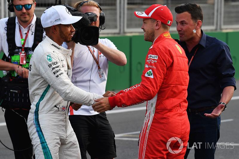 Lewis Hamilton, Mercedes-AMG F1 and Sebastian Vettel, Ferrari celebrate i n parc ferme