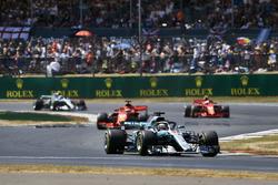 Lewis Hamilton, Mercedes AMG F1 W09, leads Sebastian Vettel, Ferrari SF71H, Kimi Raikkonen, Ferrari SF71H, and Valtteri Bottas, Mercedes AMG F1 W09