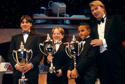 Mika Hakkinen con Gary Paffett, Tom Sisley y Lewis Hamilton