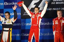 Podium: second place Fernando Alonso, Renault, winner Felipe Massa, Ferrari, third place Kimi Raikkonen, Ferrari