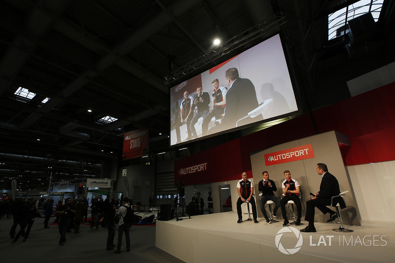 James MacNaughton, Dan Harper and Charlie Eastwood of Porsche meet Henry Hope-Frost on the Autosport Stage