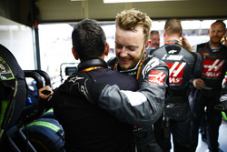 Haas team members celebrate their points finishing results