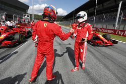 Second place Kimi Raikkonen, Ferrari, third place Sebastian Vettel, Ferrari