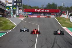 Kimi Raikkonen, Ferrari SF71H, Sebastian Vettel, Ferrari SF71H and Valtteri Bottas, Mercedes AMG F1 W09