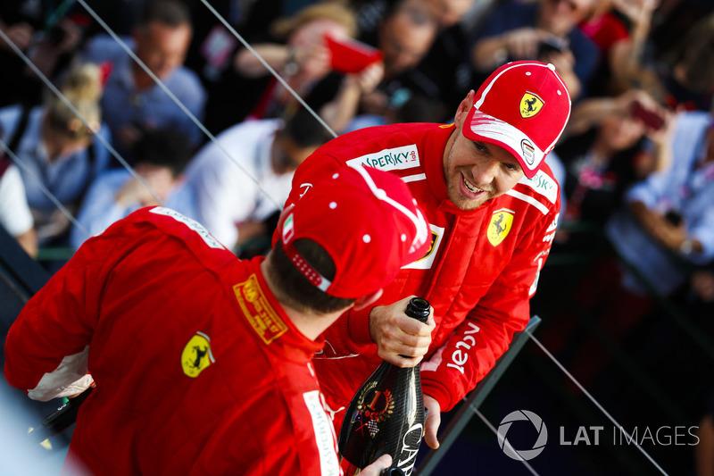 Race winner Sebastian Vettel, Ferrari, and thiod place Kimi Raikkonen, Ferrari celebrate on the podium