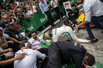 Barriers collapse as Lewis Hamilton, Mercedes AMG F1 celebrates with his mechanics in Parc Ferme