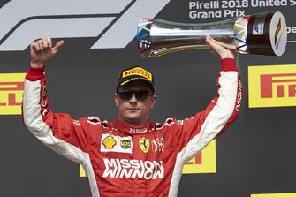 Kimi Raikkonen, Ferrari, 1st position, lifts his trophy on the podium
