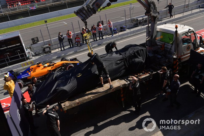 The car of Valtteri Bottas, Mercedes-AMG F1 W10 is recovered to the pits