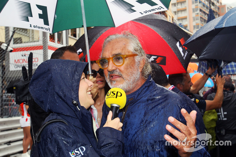(L to R): Jennie Gow, BBC Radio 5 Live Pitlane Reporter with Flavio Briatore, on the grid