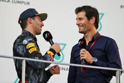 (L to R): Race winner Daniel Ricciardo, Red Bull Racing on the podium with Mark Webber, Porsche Team WEC Driver / Channel 4 Presenter