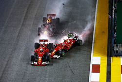 Sparks fly as Kimi Raikkonen, Ferrari SF70H hits Max Verstappen, Red Bull Racing RB13 and Sebastian Vettel, Ferrari SF70H