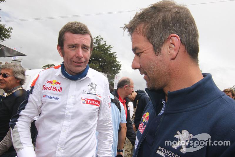 Bruno Famin, Director de Peugeot Sport, con Sébastien Loeb