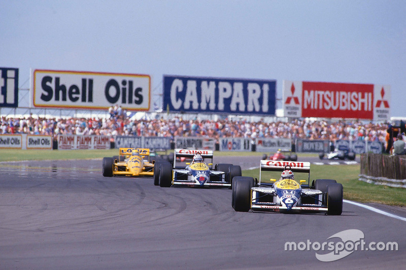 Nelson Piquet, Williams FW11B Honda, leads Nigel Mansell, Williams FW11B Honda and Ayrton Senna, Team Lotus Honda 99T