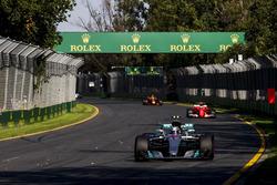 Valtteri Bottas, Mercedes AMG F1 W08, leads Kimi Raikkonen, Ferrari SF70H