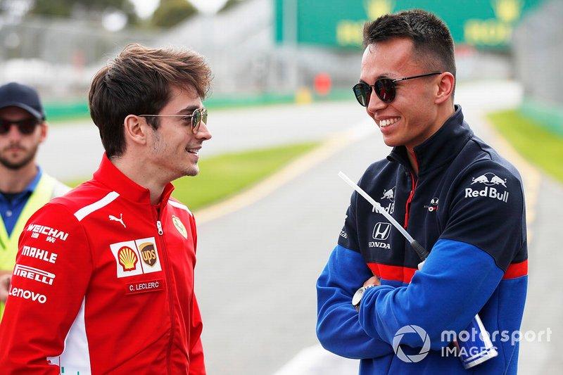 Charles Leclerc, Ferrari, and Alexander Albon, Scuderia Toro Rosso