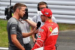 Sebastian Vettel, Ferrari talks with Jenson Button, in parc ferme