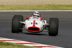 Takuma Sato drives a Honda RA300