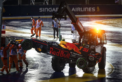 The car of Max Verstappen, Red Bull Racing RB13 is recovered by Marshals after crashing out at the start of the race