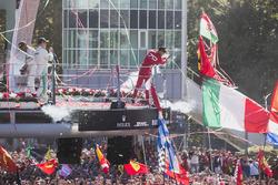 Second place Valtteri Bottas, Mercedes AMG F1, Race winner Third place Lewis Hamilton, Mercedes AMG F1 Sebastian Vettel, Ferrari, celebrate on the podium, Champagne
