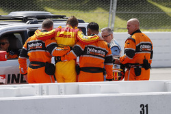 Ryan Hunter-Reay, Andretti Autosport Honda, is helped out of his car by the Holmatro Safety Team after crash