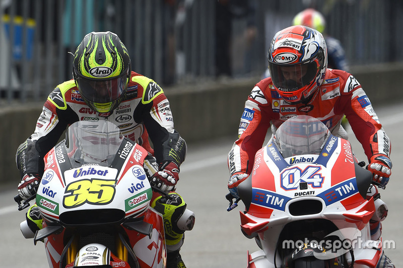 Cal Crutchlow, Team LCR Honda and Andrea Dovizioso, Ducati Team in the pitlane