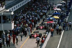 The Ferrari F186's of Michele Alboreto and Stefan Johansson, make their way down the pit lane