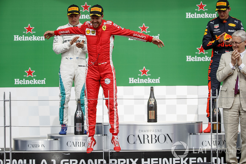 Sebastian Vettel, Ferrari, 1st position, leaps in celebration on the podium
