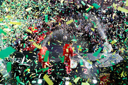 Race winner Sebastian Vettel, Ferrari, second place Lewis Hamilton, Mercedes AMG F1, third place, Kimi Raikkonen, Ferrari, celebrate on the podium as confetti rains down