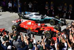 Race winner Sebastian Vettel, Ferrari SF70H and second place Valtteri Bottas, Mercedes-Benz F1 W08  in parc ferme