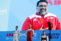Podium: Dilbagh Gill, CEO, Team Principal, Mahindra Racing, appears on the big screen as race winner Felix Rosenqvist, Mahindra Racing, second place Sébastien Buemi, Renault e.Dams, third place Sam Bird, DS Virgin Racing, celebrate on the podium