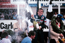 Podium: race winner Alain Prost, second place Nelson Piquet, third place John Watson