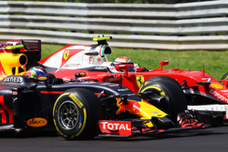 Борьба за позицию: Макс Ферстаппен, Red Bull Racing RB12, и Кими Райкконен, Ferrari SF16-H
