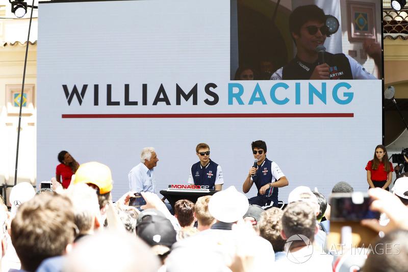 Bob Constanduros talks to Lance Stroll, Williams Racing, and Sergey Sirotkin, Williams Racing, on stage