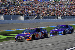 Denny Hamlin, Joe Gibbs Racing Toyota and Darrell Wallace Jr., Richard Petty Motorsports Ford Fusion on pit road