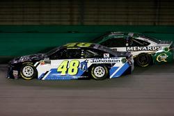Jimmie Johnson, Hendrick Motorsports Chevrolet Camaro passing Paul Menard, Wood Brothers Racing Ford Fusion