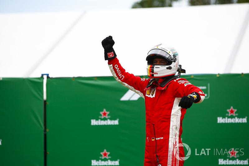 Sebastian Vettel, Ferrari, rayakan kemenangan di parc ferme