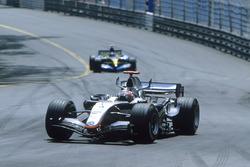 Kimi Raikkonen, McLaren MP4-20, leads Fernando Alonso, Renault R25
