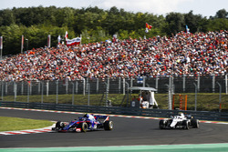 Pierre Gasly, Toro Rosso STR13, leads Sergey Sirotkin, Williams FW41