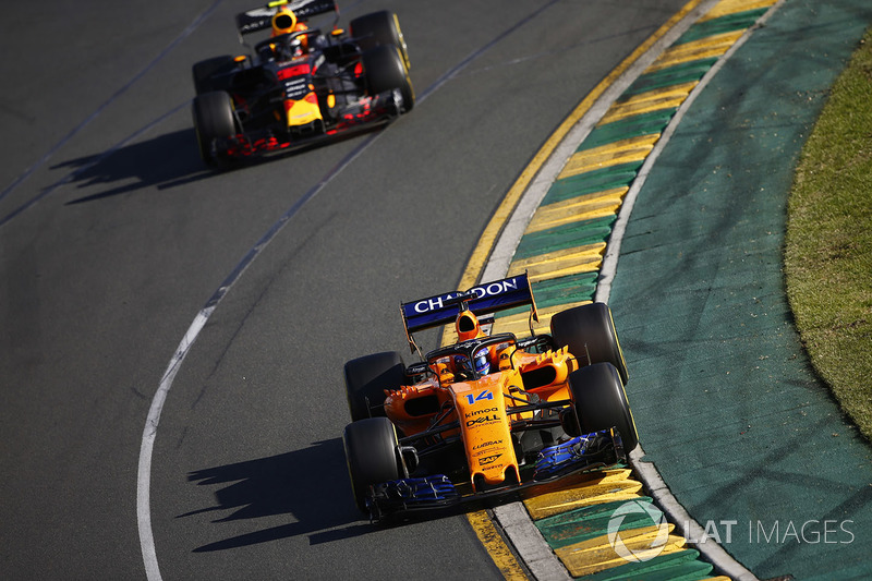 Fernando Alonso, McLaren MCL33 Renault, leads Max Verstappen, Red Bull Racing RB14 Tag Heuer