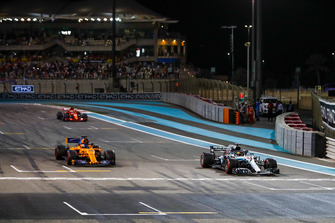 Lewis Hamilton, Mercedes AMG F1 W09 EQ Power+, Fernando Alonso, McLaren MCL33, and Sebastian Vettel, Ferrari SF71H, arrive on the grid after completing a celebration lap