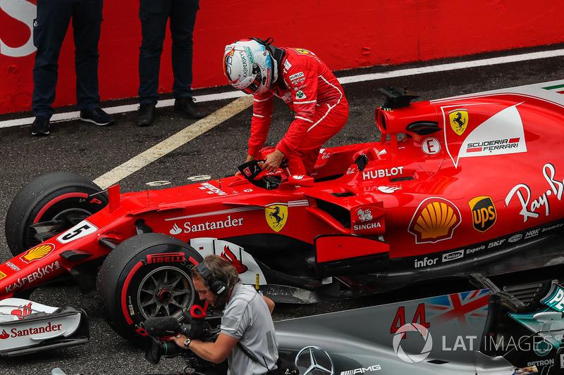 Sebastian Vettel, Ferrari SF70H arrives to celebrate in parc ferme