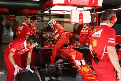 Kimi Raikkonen, Ferrari, climbs out of his car in the garage