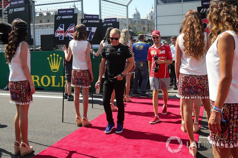 Valtteri Bottas, Mercedes AMG F1 y Sebastian Vettel, Ferrari